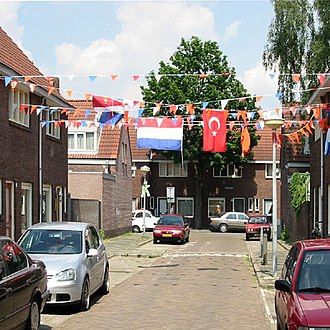 Turks in the Netherlands - Turkish flag and Dutch flag hanging side by side in the multi-ethnic neighborhood Kruidenbuurt, Eindhoven.