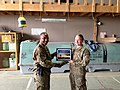 U.S. Air Force Chief Master Sgt. Kenneth Lindsey, left, the command chief master sergeant of the 455th Air Expeditionary Wing, presents a Warrior of the Week award to Airman 1st Class Tasha Johnson, a combat 131106-F-UR349-001.jpg