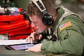 U.S. Air Force Staff Sgt. Michael Stevens, an aeromedical service journeyman with the 86th Aeromedical Evacuation Squadron, goes over medical information in a C-17 Globemaster III aircraft during Joint Readiness 140313-F-RW714-223.jpg