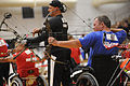 U.S. Air Force Staff Sgt. Rick Pollock lines up a shot while competing in the compound category of the archery competition at the Warrior Games May 12, 2010, at the Olympic training center in Colorado Springs 100512-F-KR851-005.jpg