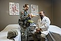 U.S. Army 2nd Lt. Nicole Boda, a maintenance officer for the 863rd Engineer Battalion, interacts with Dr. Jaimin G. Shah, a physical therapist with the health and wellness division at the Argonne National 140826-A-TI382-710.jpg