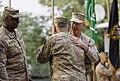 U.S. Army Gen. John F. Campbell, foreground, hugs Marine Corps Gen. Joseph F. Dunford Jr 140826-D-HU462-629.jpg