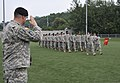 U.S. Army Lt. Col. Joe Suddith, the incoming commander of the 498th Combat Sustainment Support Battalion, salutes his Soldiers during a pass in review for a change of command ceremony at Camp Carroll, South 140613-A-NY467-008.jpg