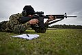 U.S. Marine Corps Sgt. Cody R. Nelson, with the III Marine Expeditionary Force combat shooting team, fires at a 300-meter target during the first day of competition at the 2012 Australian Army Skills at the Arms 120507-F-MQ656-155.jpg