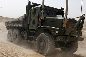 U.S. Marine Lance Cpl. Wesley J. Henkel, a motor transport operator with Marine Wing Support Squadron (MWSS) 271, drives a medium tactical vehicle replacement at Camp Bastion, Helmand province, Afghanistan 130807-M-SA716-007.jpg