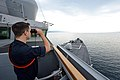 U.S. Navy Ensign Shea Miller watches for outbound civilian merchant traffic aboard the guided missile destroyer USS Ross (DDG 71) in the Dardanelles en route to the Black Sea Sept 140903-N-IY142-123.jpg