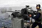 U.S. Navy Machinist's Mate 2nd Class Joselito Andrade fires a 25 mm machine gun during live-fire exercises aboard the submarine tender USS Emory S. Land (AS 39) in the Pacific Ocean June 6, 2013 130606-N-GL207-126.jpg
