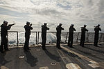 U.S. Sailors aboard the guided missile destroyer USS Gravely (DDG 107) render a 21-gun salute during a burial at sea March 7, 2014, in the Atlantic Ocean 140307-N-DQ840-321.jpg