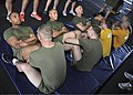 U.S. Sailors and Marines participate in the physical readiness test portion of the Marine-based Professional Military Education class in the hangar bay of the aircraft carrier USS Nimitz (CVN 68) in the Pacific 130504-N-BJ752-129.jpg