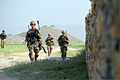 U.S. Soldiers with Echo Company, 2nd Battalion, 506th Infantry Regiment, 4th Brigade Combat Team, 101st Airborne Division walk toward a village June 2, 2013, during a mission in Khost province, Afghanistan 130602-A-DQ133-145.jpg
