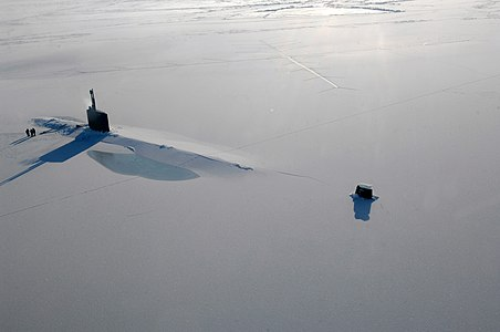 """The US Navy attack submarine USS Annapolis (SSN 760) rests in the Arctic Ocean after surfacing through three feet of ice during Ice Exercise 2009 on March 21, 2009. The two-week training exercise, which is used to test submarine operability and war-fighting capability in Arctic conditions, also involved the USS Helena (SSN 725), the University of Washington and personnel from the Navy Arctic Submarine Laboratory."""