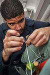 USS Carl Vinson Sailors conduct parachute maintenance 141111-N-TP834-089.jpg