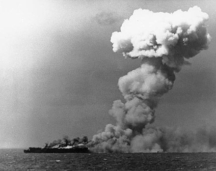October 23: Battle of Leyte Gulf between United States and Japan during World War II. USS Princeton (CVL-23) burning on 24 October 1944 (80-G-287970).jpg
