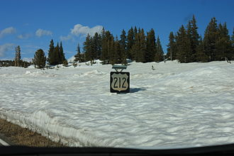 U.S. Route 212 - U.S. 212 sign nearly buried in snow during late May 2009 in Wyoming