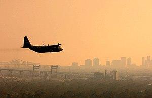Environmental impact of pesticides - Spraying a mosquito pesticide over a city