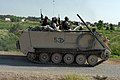US Army (USA) Soldiers assigned to C Company, 1ST Engineers, 1ST Infantry Division Brigade Combat Team 1 (BCT-1), travel aboard a USA M113 Armored Personnel Carrier (APC), as they d - DPLA - a97d2ed609c0b32e8263cc1874c15de8.jpeg