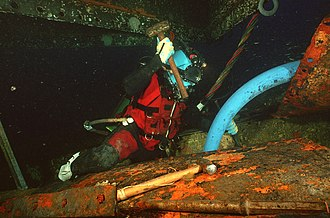 Saturation diving - Saturation diver working on the USS Monitor wreck at 70 m (230 ft) depth.