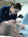US Navy 030401-N-4182M-002 Ensign Rachel Edelson, N.C., gives a coalition patient an injection in one of the hospital wards while deployed in support of Operation Iraqi Freedom.jpg