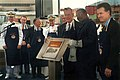 US Navy 030906-N-2383B-143 President George H.W. Bush holds up a plaque with his initials inscribed by shipyard welder Mike Eaton.jpg