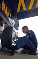 US Navy 040606-N-7559C-001 Aviation Structural Mechanic 1st Class Mario Delacruz, from El Paso, Texas, wipes brake dust from the tire rim of a Blue Angels F-A-18A Hornet.jpg