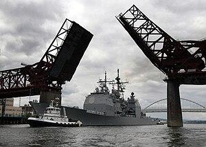 USS Lake Erie (CG-70) - Lake Erie passes under a drawbridge on the Willamette River en route to Portland, Oregon, for the 97th Annual Rose Festival