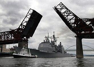 USS Lake Erie (CG-70) - Lake Erie under tow passing under a drawbridge on the Willamette River en route to Portland, Oregon