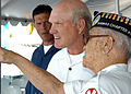 US Navy 040902-N-3019M-002 National Football League (NFL) Hall of Fame quarterback Terry Bradshaw listens to a Pearl Harbor survivor as he describes his experiences aboard USS Missouri.jpg