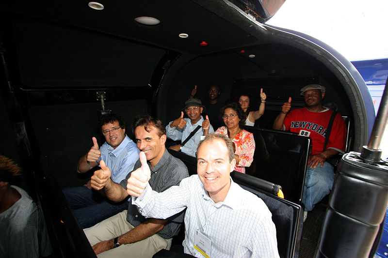 Passengers give a thumb up as they ready for takeoff