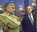 US Navy 050727-N-2899A-001 Commander of Multinational Force Iraq, U.S. Army Gen. George Casey and Secretary of Defense Donald Rumsfeld answer questions during a press conference at the U.S. Embassy in Baghdad, Iraq.jpg