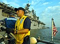 US Navy 050909-N-6204K-017 Seaman Juventino Lebron pilots a Rigid Hull Inflatable Boat (RHIB) boat past the amphibious assault ship USS Iwo Jima (LHD 7).jpg