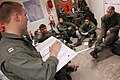 US Navy 060327-N-6074Y-003 Lt. Greg C. Knutson, a pilot assigned to Helicopter Anti-Submarine Squadron Two (HS-2) Golden Falcons, briefs fellow pilots and air crew prior to an evening combat search and rescue (CSAR) training mi.jpg