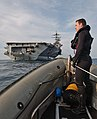 US Navy 060516-N-6410T-012 Boatswain's Mate 2nd Class William Robertson, a search and rescue (SAR) swimmer assigned to the Nimitz-class aircraft carrier USS Theodore Roosevelt (CVN 71) stands aboard a Rigid Hull Inflatable Boat.jpg