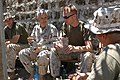 US Navy 060812-N-0411D-261 U.S. Navy Capt. Tim Moon, left center, chats with U.S. Marine Sgt. Jeremy Willett of Portland, Ore., about the improvements in the typical Meal Ready to Eat (MRE).jpg