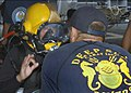 US Navy 060815-N-7415V-004 A Navy diver assigned to the rescue and salvage ship USS Salvor (ARS 52) checks Philippine Navy diver Seaman 2nd Class Melodina Besana prior to a pierside diving event.jpg