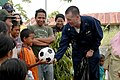 US Navy 060816-N-3714J-070 Navy Chaplain, Cmdr. Donald Fix of Pittsburgh, Pa., assigned aboard the Military Sealift Command (MSC) hospital ship USNS Mercy (T-AH 19), awards a boy a soccer ball.jpg