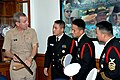 US Navy 061025-N-1592S-001 Commander, Naval Service Training Command, Rear Adm. Gary R. Jones shows his office keepsakes to Chief Quartermaster ManSuk Woo (left) and Kichun Nam, drill instructors with the Korean Navy.jpg