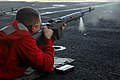 US Navy 061030-N-8119R-030 Gunner's Mate Seaman Patrick Cornwell fires a M-14 semi-automatic rifle during a live-fire exercise aboard the nuclear-powered aircraft carrier USS Nimitz (CVN 68).jpg