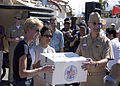 US Navy 070704-N-6410J-113 U.S. Ambassador to the Philippines, the Honorable Kristie A. Kenney and Vice Admiral Doug Crowder hand a box to a Philippine official during Project Handclasp ceremony.jpg