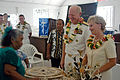 US Navy 070829-N-6410J-182 Commander, U.S. Pacific Fleet Adm. Robert F. Willard and wife Donna receive gifts from local citizens during a visit to a local church in Majuro.jpg
