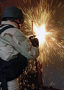 US Navy 071209-N-2838W-117 Damage Controlman 3rd Class Kiel Durant, a member of guided-missile cruiser USS Philippine Sea's (CG 58) Visit, Board, Search and Seizure (VBSS) team, uses a breaching procedure to open a welded shut