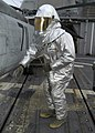 US Navy 080118-N-4649C-033 A Sailor wearing a fire-retardant suit checks for hot spots during a crash and smash drill aboard the guided-missile cruiser USS Shiloh (CG 67).jpg