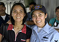 US Navy 080201-N-4649C-051 Storekeeper 3rd Class Gidel Torres reunites with one of her seven sisters aboard the guided-missile cruiser USS Shiloh (CG 67) during a port visit in Manila.jpg