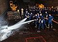 US Navy 080602-N-7987H-040 Midshipmen embarked aboard the amphibious dock landing ship USS Ashland (LSD 48) practice hose handling techniques with Damage Controlmen in the well deck.jpg