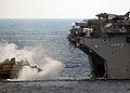 US Navy 080712-N-3392P-016 A landing craft air cushion assigned to Assault Craft Unit 4 enters the well deck of the multi-purpose amphibious assault ship USS Iwo Jima (LHD 7).jpg