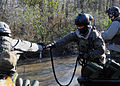 US Navy 081205-N-4500G-060 A special warfare combatant-craft crewman hands off a tow line on a special operations craft-riverine during a two-week coxswain training exercise for Special Boat Team (SBT) 22.jpg
