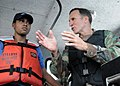 US Navy 090415-N-4143O-007 Rear Adm. Joseph D. Kernan, Commander, U.S. 4th Fleet, discusses small boat training operations with Jamaican Coast Guard Sub-Lieutenant Anneka Thompson, a Southern Partnership Station participant.jpg