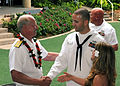 US Navy 090423-N-3283M-069 Adm. Robert F. Willard, commander, U.S. Pacific Fleet, congratulates Hospital Corpsman 1st Class James Nicholson for his selection as the 2009 Pacific Fleet Shore Sailor of the Year.jpg