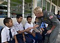 US Navy 090624-N-1722M-309 Rear Adm. Nora W. Tyson, Commander, Logistics Group Western Pacific, greets boys at Seberan Tayor Primary School during a Cooperation Afloat Readiness and Training (CARAT) Malaysia 2009 community serv.jpg