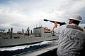 US Navy 090624-N-9689V-003 Ship's Boatswain Dave Floyd fires a guide line from the Military Sealift Command dry cargo-ammunition ship USNS Richard E. Byrd (T-AKE 4) to the Military Sealift Command dry cargo-ammunition ship USNS.jpg