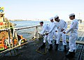 US Navy 100405-N-9301W-030 Sailors aboard the guided-missile frigate USS Klakring (FFG 42) take a line from a tugboat to get the ship underway.jpg